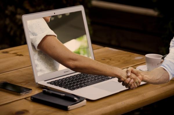 arm reaching through the laptop.