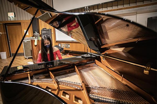 A student has a solo piano lesson.